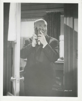 ALFRED HITCHCOCK CLOWNS AROUND ON SET OF PSYCHO (1960)