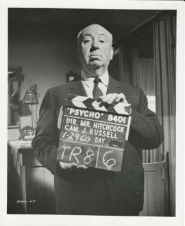 ALFRED HITCHCOCK WITH CLAPPER BOARD FOR PSYCHO (1960)